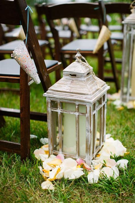 Vintage style lanterns with candles and flower petals as