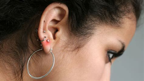 why you don t want an infected ear piercing inkdoneright