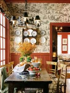 Has a charming black and white toile mixed with red paneling more