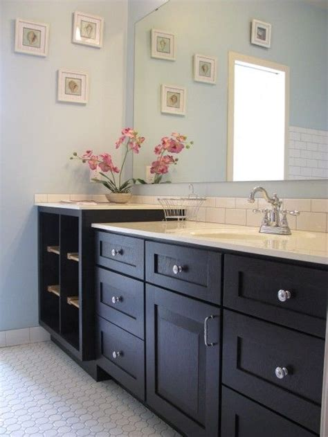 bathroom with dark cabinets light blue bathroom with white countertop subway tile and