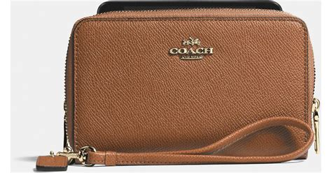 Coach 54446 Light Saddle coach zip phone wallet in embossed textured leather in light gold saddle lyst