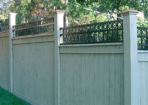 custom wood and wrought iron fence with copper caps http