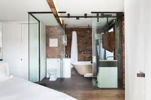 Awesome modern walk in shower with rain showerhead and bedroom view