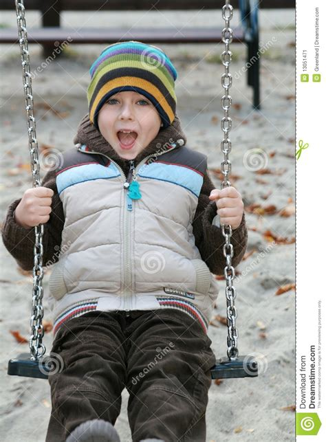 kid on swing kid on a swing stock image image 13051471