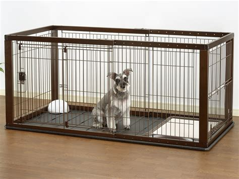 crate puppy at expandable crate in pet pens