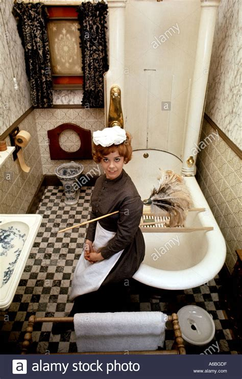 maid in bathroom a victorian bathroom with house maid in period costume at