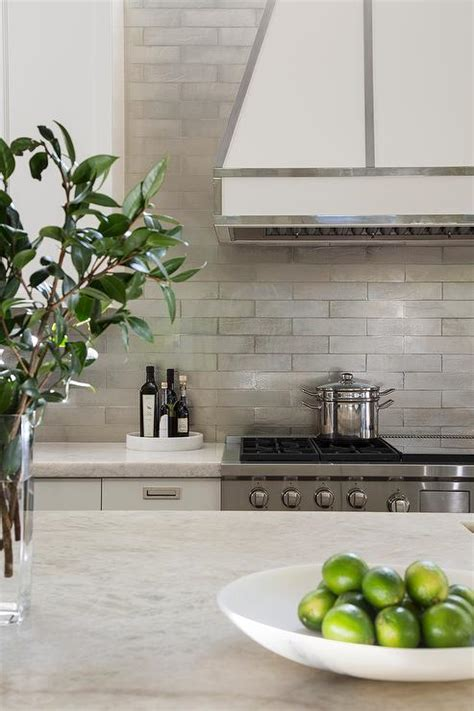 ivory  white kitchen  gray metallic tile backsplash