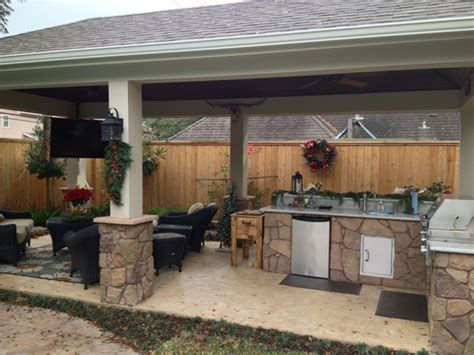 Kitchen Bar Island Ideas by Poolside Patio Featuring Stone Kitchen And Bar