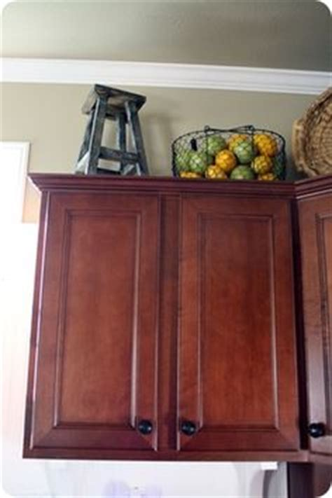 baskets on top of kitchen cabinets 1000 images about refrigerator decor on pinterest