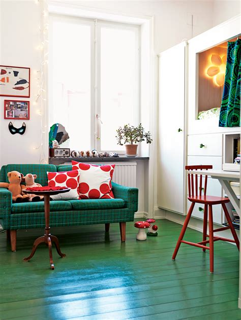 painted bedroom floors the painted green wood floors give a cheery look to this