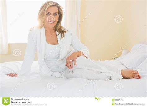 granny bed content woman looking at camera posing on her bed stock images image 33387274