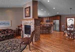 two sided fireplaces dining room rustic with area rug