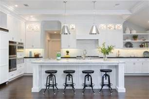 white kitchen with island kitchen island with white quartzite countertop