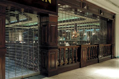 upward coiling security grilles models