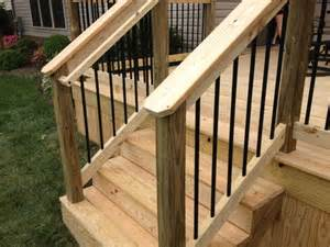 black aluminum spindles and graspable handrail wood