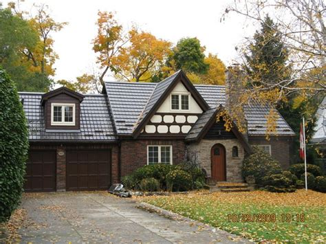 tudor style home with a hy grade roof home inspirations pinterest
