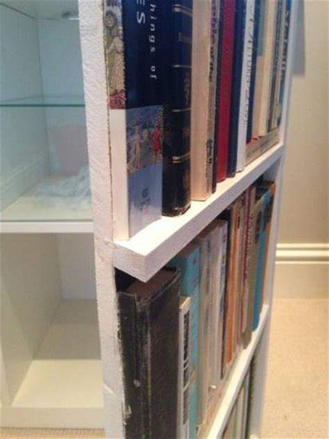 display with false bookcase doors boing boing