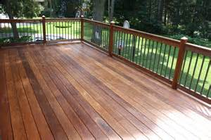 An ipe deck with mahogany posts metal bronze traditional balusters