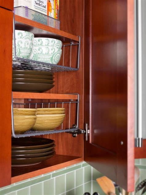 adding shelves to kitchen cabinets how to add extra storage space to your small kitchen