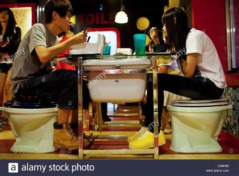 toilet restaurant a young couple enjoys dinner at modern toilet restaurant