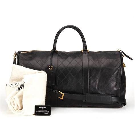 Quilted Travel Bag by 1990s Chanel Black Quilted Lambskin Vintage Boston Travel