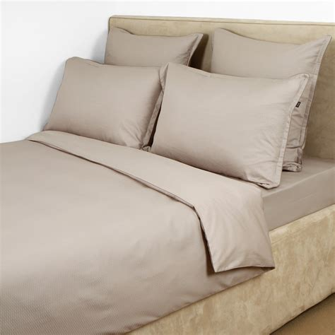 bed sheet materials buy hugo boss loft fitted sheet cement amara