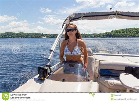 women on boats women driving a pontoon boat on a lake stock photo image