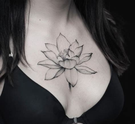 tattoos in between breast sternum between the breast design ideas