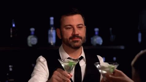bond martini gif clink gif cheers clink martini discover gifs