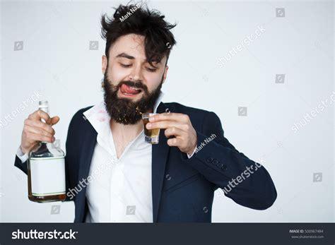 young man with beard wallpaper young man beard drunk bearded male stock photo 500967484
