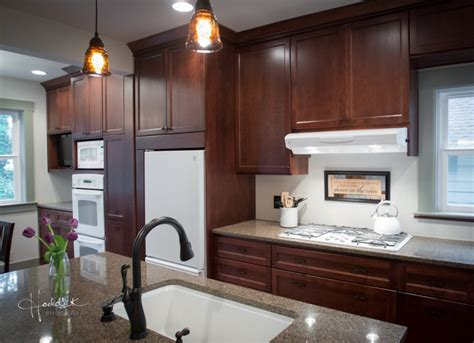 kitchens with white appliances dark oak cabinets with white countertops and white