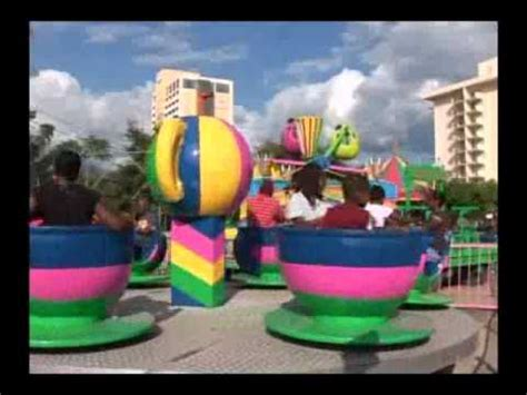 Theme Park Jamaica Lyrics | cup saucer ride at putt n play jamaica youtube