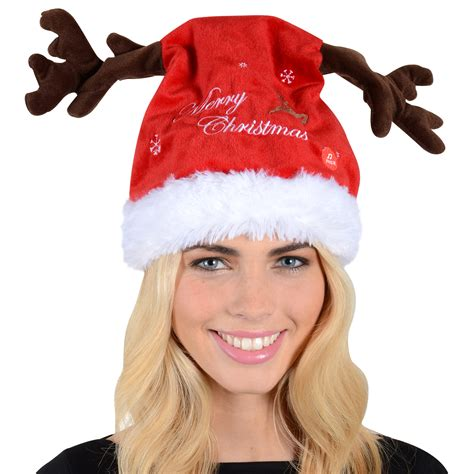 funny dancing santa hat with reindeer antlers plays jingle