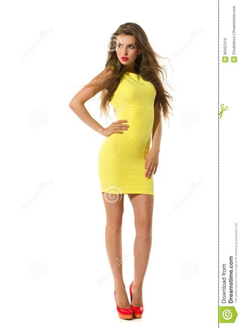Dress Model Style Impor Yellow Purple Pink posing in yellow fitted mini dress stock photo image 66457014