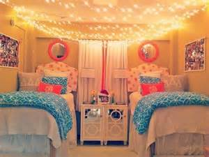 Dorm room hanging string lights across ceiling pink and blue colour
