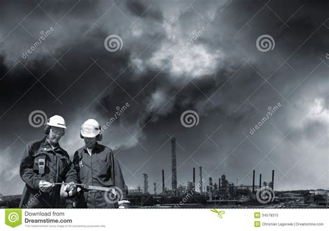 two workers fatally overcome by gas at the norske skog paper mill of albury the wimmera two industry workers and distant refinery royalty free stock photo image 34578315