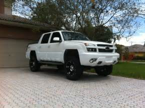 lifted white chevy avalanche the aggressive look the
