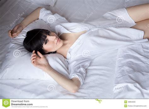 lying down in bed beautiful girl lying down in bed stock image image 48894033