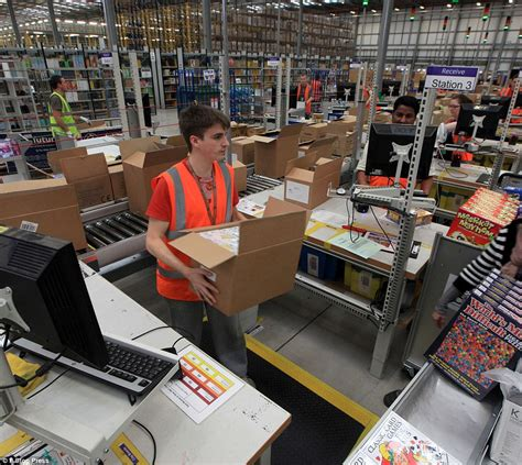 Working Online From Home Uk - black friday amazon staff work round the clock to package thousands of gifts as sales