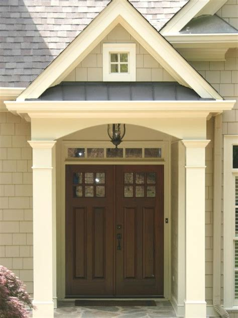 house front door portico with a combination of materials wood metal