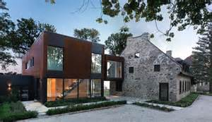 Stone Farmhouse Plans by Traditional Stone Farmhouse Extended With Glass And Steel
