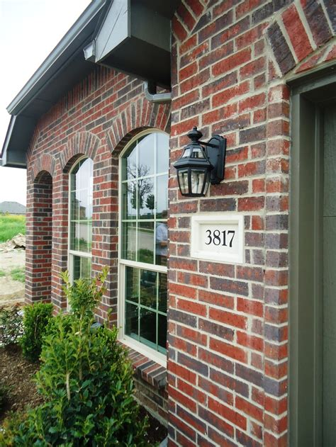 village homes     details deep red brick