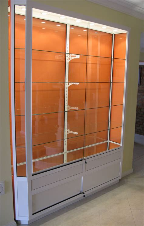 Contemporary Wall Display Cabinet Feature Clear Glass Wall Display Cabinets With Glass Doors