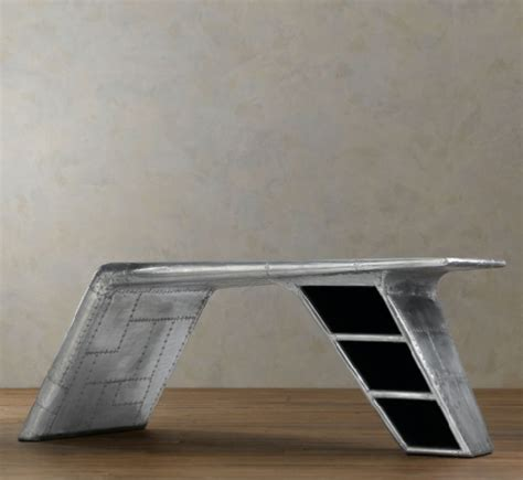 original desk mimicking the bent wing of a plane