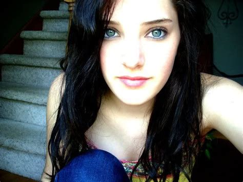 girl with black hair blue eyes a girl with black hair in a pony tail anf ice blue eyes