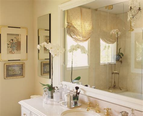 window dressing for bathroom master bath with crema marfil marble and mirrored silk