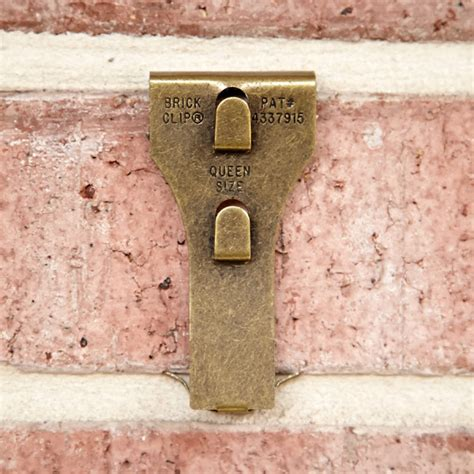 how to hang a picture on a brick wall brick clips the container store
