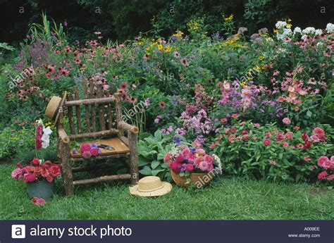 Rustic Flower Garden Garden Rustic Chair In Home Flower Garden Of Pinks And Reds Stock Photo Royalty Free