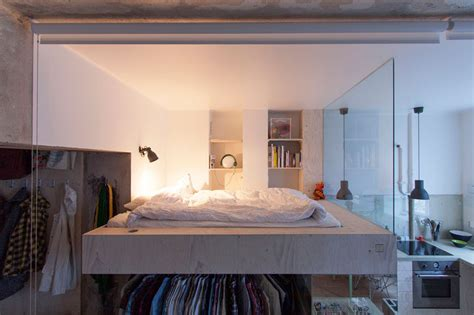 Bed With Walk In Closet Underneath by This Architect Made A Small Apartment Liveable By