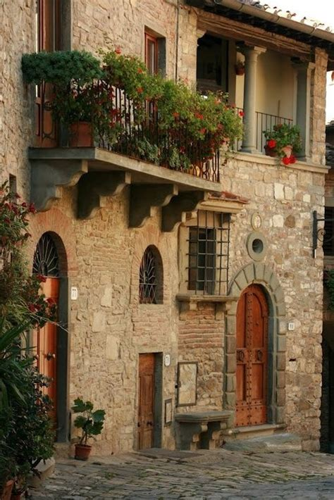 houses in italy european stone bracket balcony on stone house tuscany